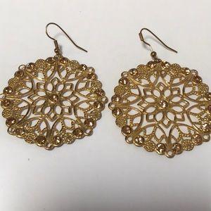 Gold tone earrings with yellow rhinestones
